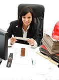 Architect with plans. Female architect with house plans in her office Royalty Free Stock Image