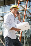 Architect With Plans Outside New Home Royalty Free Stock Photos