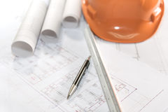 Architect plans project drawing and pen with blueprints rolls stock photography