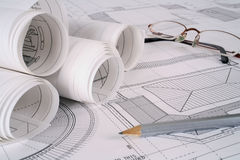 Architect plans series. Architect plans and rolls used in construction.More in portfolio Royalty Free Stock Image
