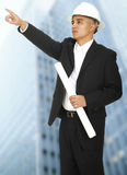 Architect Pointing With Building Background Royalty Free Stock Images