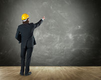 Architect pointing to a concrete wall Royalty Free Stock Photo