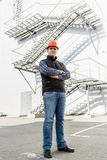 Architect posing against metal construction Stock Images