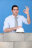 Architect posing near wall Stock Photo