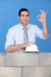 Architect posing near wall Stock Photo