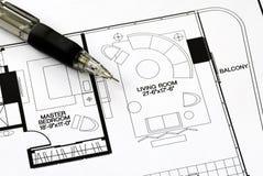 An architect prepares the floorplan. An architect prepares the floor plan for a residence Stock Photo