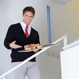 Architect presenting house model Stock Photo