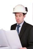 Architect reading plans stock image