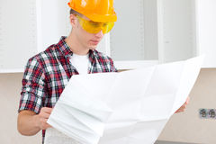 Architect  with repair plan Stock Photography
