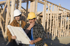 Architect Reviewing Blueprint With Worker Royalty Free Stock Images