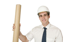 Architect with roll on white. Upper view of a young man in a white shirt with a tie and white construction helmet holding a gray cardboard tube against white stock photography