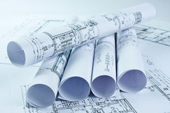 Architect rolls and house plan Royalty Free Stock Photography