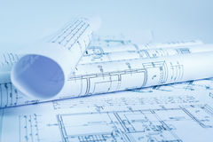 Architect rolls and house plans Royalty Free Stock Photos