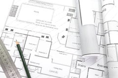 Architect rolls and plans Royalty Free Stock Photo