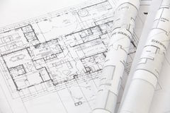 Architect rolls and plans Stock Photos