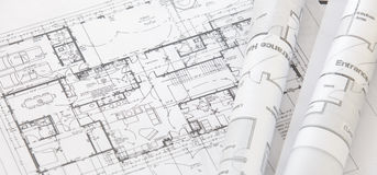 Architect rolls and plans. Architectural plan,technical project drawing royalty free stock images