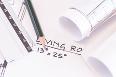 Architect rolls and plans construction project Royalty Free Stock Image