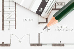 Architect rolls and plans construction project Stock Photo