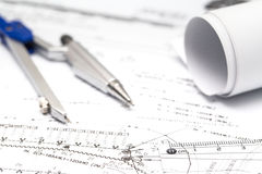 Architect rolls and plans construction project drawing Stock Image
