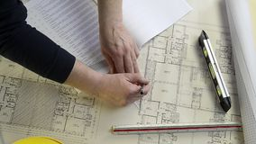 Architect rolls and plans construction project drawing stock video footage