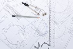 Architect rolls and plans construction project drawing Royalty Free Stock Image