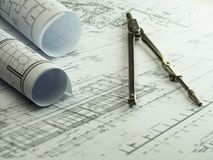 Architect rolls and plans with divider. Architectural plan, tech royalty free stock photography