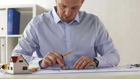 Architect with ruler, compass and blueprint stock footage
