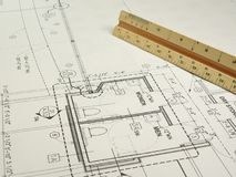 Architect's Drawing. An architect's wrokspace with rolled plans, a drawing in progress, and equipment Royalty Free Stock Photography