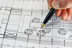 Architect pointing with pen on blueprint of the project. Architect`s hand pointing with pen on blueprint of the project Royalty Free Stock Photo