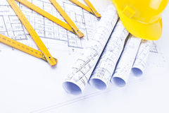 Architect`s rolls and construction tools Stock Image