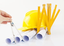 Architect`s rolls and construction tools Stock Images
