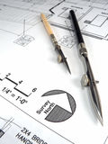 Architect's Tools and Plans. A closeup of an architect's desktop with various tools of the trade, blueprints, and design drawings Stock Photography