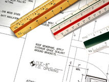 Architect's Tools and Plans. A closeup of an architect's desktop with various tools of the trade, blueprints, and design drawings Stock Image