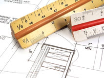 Architect's Tools and Plans. A closeup of an architect's desktop with various tools of the trade, blueprints, and design drawings Royalty Free Stock Photos
