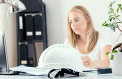 Architect`s white helmet in the central point Stock Images