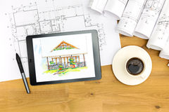 Architect's workspace with tablet and blueprints Royalty Free Stock Image