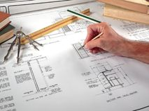 Architect's Workspace, Tools, and Blueprints. A closeup of an architect's office workspace showing his design blueprints and tools of the trade Stock Photo