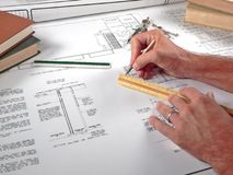 Architect's Workspace, Tools, and Blueprints. A closeup of an architect's office workspace showing his design blueprints and tools of the trade Stock Image
