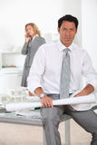 Architect sat at desk Stock Image