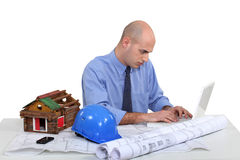 Architect sat at desk Royalty Free Stock Image