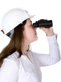 Architect searching with binoculars Stock Photos