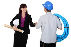 Architect shaking electricians hand. A architect shaking electricians hand Stock Photos