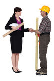 Architect shaking hands with builder Stock Photo
