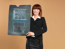 Architect showing blueprint of house Royalty Free Stock Photos