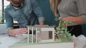 Architect showing his house plan to a client. stock video footage