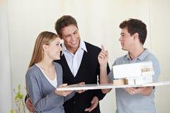 Architect showing house model Stock Photo