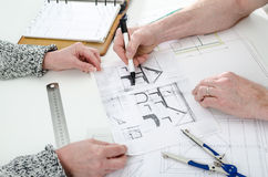 Architect showing house plans. To his client Royalty Free Stock Photos