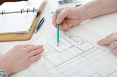 Architect showing house plans Stock Photography