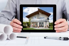 Architect showing picture of house Royalty Free Stock Images