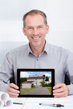 Architect Showing Picture Of House Royalty Free Stock Photography